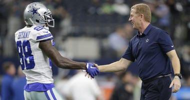 Dallas Cowboys wide receiver Dez Bryant (88) shakes hands with head coach Jason Garrett before a game