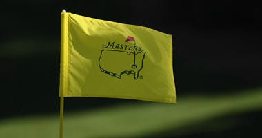 The flag on the 10th green blows in the wind during the second round of The Masters golf tournament at Augusta National Golf Club