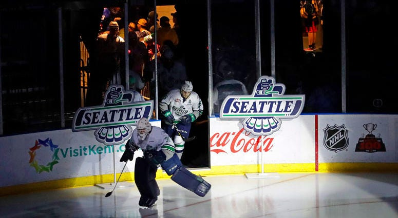In this Jan. 9, 2018, file photo, fans cheer at the ShoWare Center in Kent, Wash., about 20 miles south of Seattle