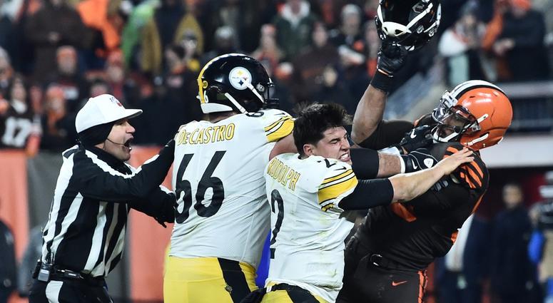 ; Cleveland Browns defensive end Myles Garrett (95) hits Pittsburgh Steelers quarterback Mason Rudolph