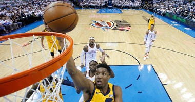 Utah Jazz guard Donovan Mitchell (45) shoots during the first half of Game 2 of an NBA basketball first-round playoff series against the Oklahoma City Thunder in Oklahoma City, Wednesday, April 18, 2018.