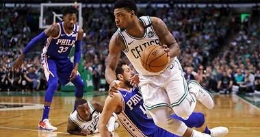Boston Celtics guard Marcus Smart, right, drives past Philadelphia 76ers guard Marco Belinelli during the first quarter of Game 5 of an NBA basketball playoff series in Boston,