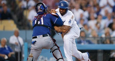Los Angeles Dodgers' Matt Kemp, right, shoves Texas Rangers catcher Robinson Chirinos