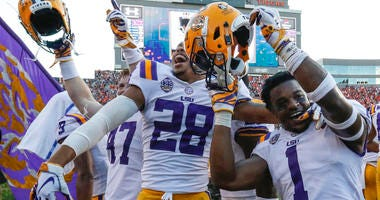LSU players celebrate after they defeated Auburn on a last second field goal during the second half of an NCAA college football game, Saturday, Sept. 15, 2018, in Auburn, Ala. LSU won 22-21.