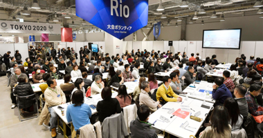 invitees listen during an orientation for volunteers for the Tokyo 2020 Olympics