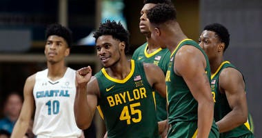Baylor guard Davion Mitchell (45) guards Coastal Carolina guard Devante Jones (3) during the second half of an NCAA college basketball game at the Myrtle Beach Invitational in Conway, S.C., Friday, Nov. 22, 2019. (