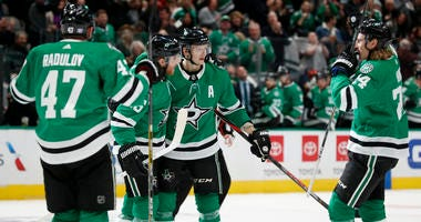 Dallas Stars' Blake Comeau, left, Mattias Janmark (13) and goaltender Anton Khudobin, right, celebrate after a shoot-out against the Chicago Blackhawks in an NHL hockey game in Dallas, Saturday, Nov. 23, 2019. The Stars won 2-1