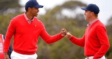 U.S. team player and captain Tiger Woods, left, and teammate Justin Thomas