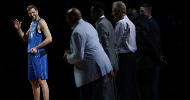 Dirk Nowitzki #41 of the Dallas Mavericks stands in front of Charles Barkley, Scottie Pippen, Larry Bird, Shawn Kemp and Detlef Schrempf after his last home game at American Airlines Center on April 09, 2019 in Dallas, Texas.