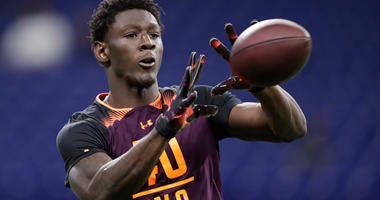 Georgia wide receiver Riley Ridley runs a drill at the NFL football scouting combine in Indianapolis, Saturday, March 2, 2019.