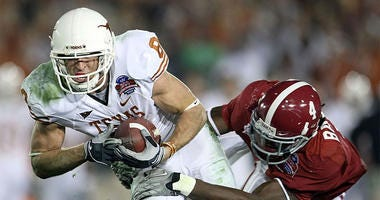 Wide receiver Jordan Shipley #8 of the Texas Longhorns is tackled by cornerback Mark Barron #4 of the Alabama Crimson Tide