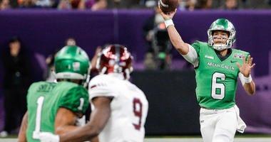North Texas Mean Green quarterback Mason Fine (6) throws against the Troy Trojans