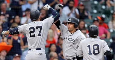 New York Yankees right fielder Giancarlo Stanton (27) celebrate his two-run home run with New York Yankees catcher Gary Sanchez