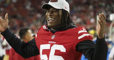 San Francisco 49ers linebacker Reuben Foster (56) celebrates on the sideline during the fourth quarter against the Los Angeles Chargers at Levi's Stadium.