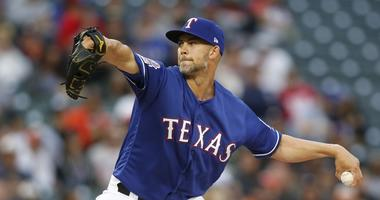Texas Rangers starting pitcher Mike Minor (23) pitches in the first inning against the Houston Astros at Globe Life Park in Arlington.