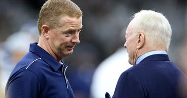 Dallas Cowboys head coach Jason Garrett talks to team owner Jerry Jones