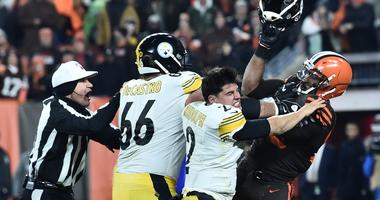 ; Cleveland Browns defensive end Myles Garrett (95) hits Pittsburgh Steelers quarterback Mason Rudolph