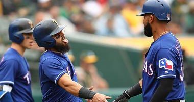 Texas Rangers' Rougned Odor, center, celebrates with Nomar Mazara