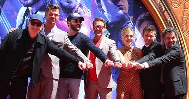 "Kevin Feige, Chris Hemsworth, Chris Evans, Robert Downey Jr., Scarlett Johansson, Mark Ruffalo, Jeremy Renner. Marvel Studios' ""Avengers: Endgame"" Cast Place Their Hand Prints In Cement held at TCL Chinese Theatre."