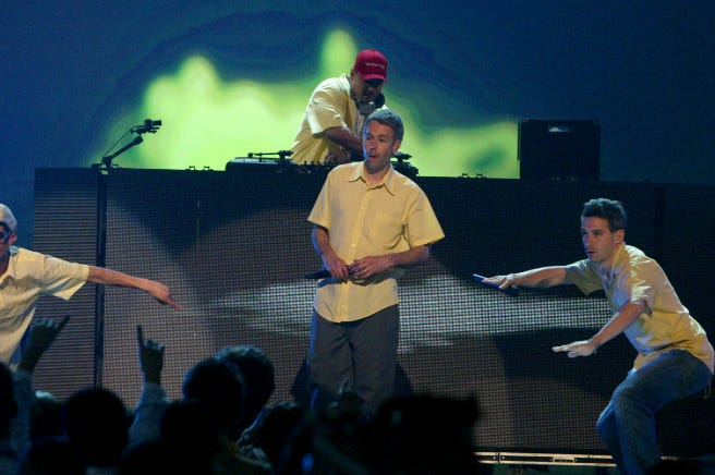 The Beastie Boys perform on stage at the 2004 MTV Movie Awards