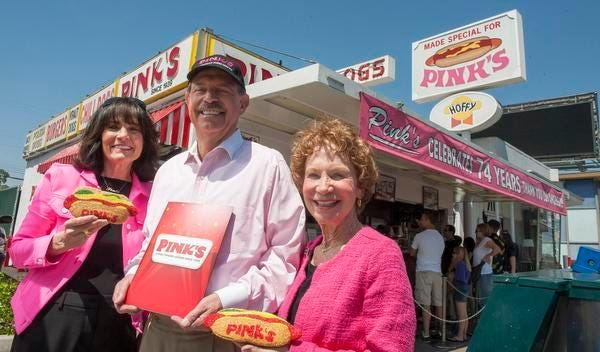 Pink's Hot Dogs owners Gloria and Richard Pink, and Beverly Pink-Wolfe