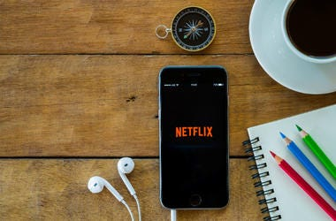 Netflix apps showing on iphone 6s.Netflix is an American provider of on-demand Internet streaming media available founded in 1997 by Marc Randolph and Reed Hastings
