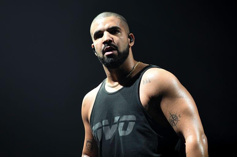 Drake in black tank top