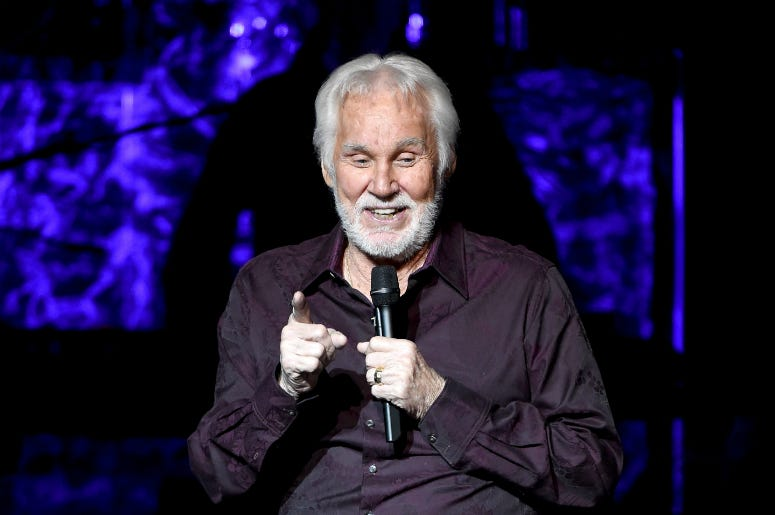 "Kenny Rogers performs onstage during his final world tour ""The Gambler's Last Deal"""