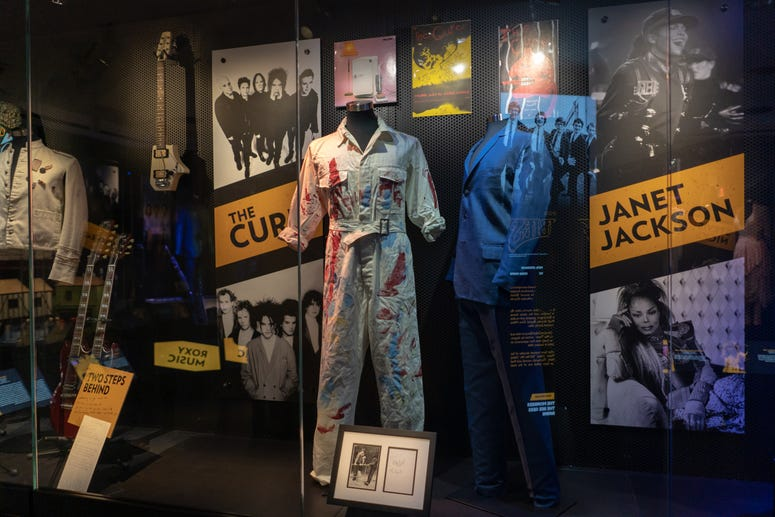 Select items from new Inductees The Cure on display.