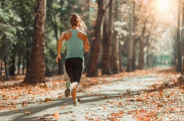 Woman running in autumn