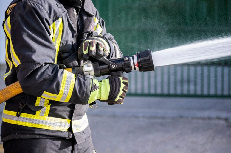 Firefighter using a hose