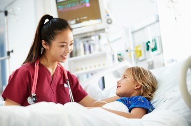 Young girl and nurse in the hospital