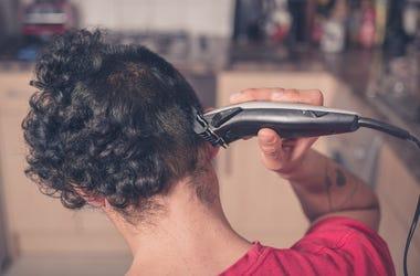 Guy cuts his own hair