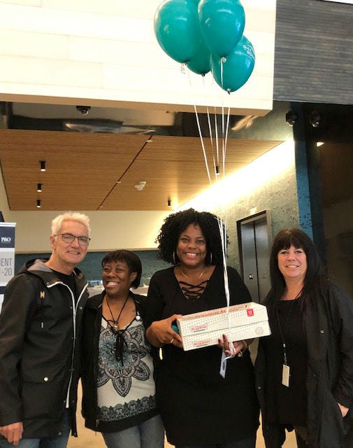 John & Jeanne with donut winners at Holland America Lines