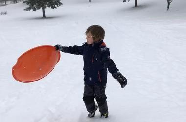 Dawson with a snow saucer