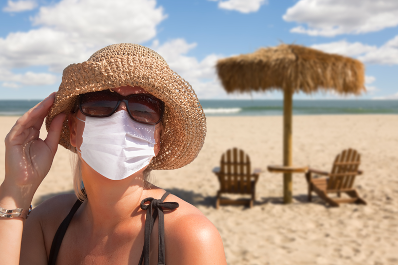 Woman wearing mask on beach