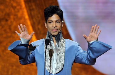 Prince speaks onstage at the 42nd NAACP Image Awards
