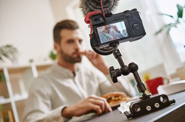 Guy making a food video