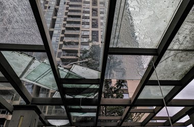 Broken glass in downtown building after severe weather