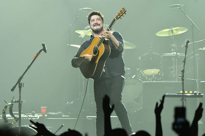 Marcus Mumford of Mumford & Sons on stage