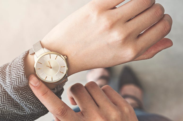 Woman Checking Watch, Standing Up