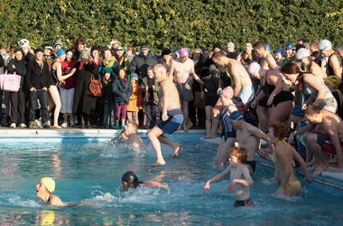 People Jumping into a freezing pool