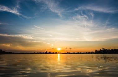 Beautiful sunset on lake horizon