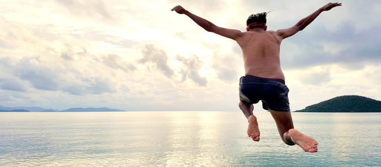 Man Jumping In Water 775x515 New Swimwear Company Goes Viral After Debut Of The Brokini 8211 Talk Radio 1210 WPHT