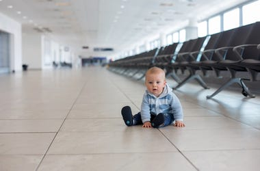 Baby alone at airport