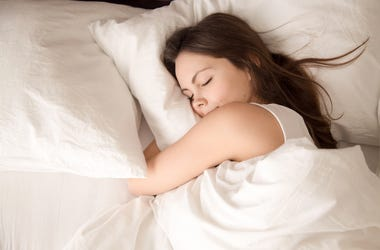 Woman Sleeping, Hugging Pillow
