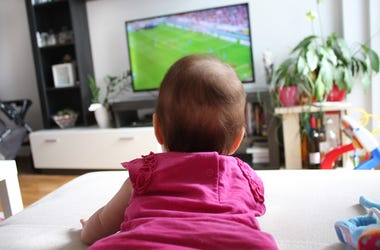 Baby Watching Soccer