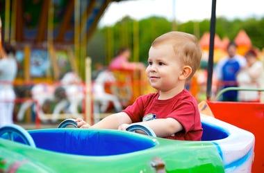 Child At An Amusement Park