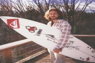 Eddie Vedder with signed surf board