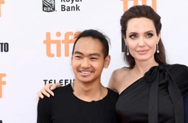 Maddox Jolie-Pitt and Angelina Jolie